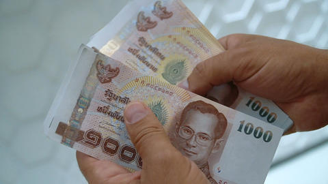 Person counting Thai baht Footage