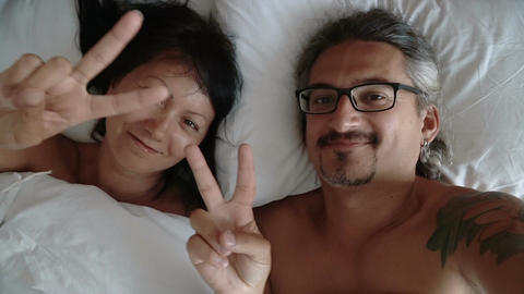 Happy couple making selfie in the bed Footage
