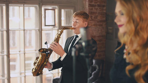 Jazz vocalist perform on stage with saxophonist. Song. Musicians. Live concert Footage