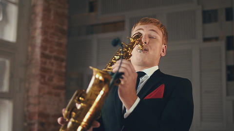 Saxophonist in dinner jacket play on golden saxophone. Jazz artist. Performance Footage
