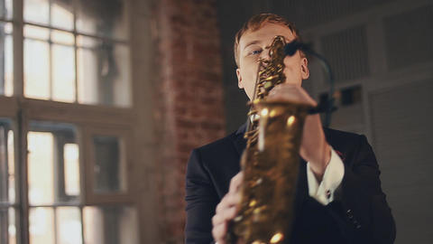 Saxophonist in black suit play jazz on golden saxophone. Musician. Performing Footage