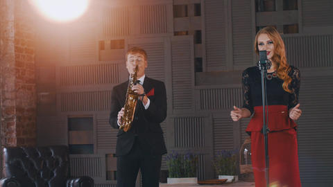 Jazz duet perform on stage. Saxophonist and vocalist. Retro style. Artists Footage