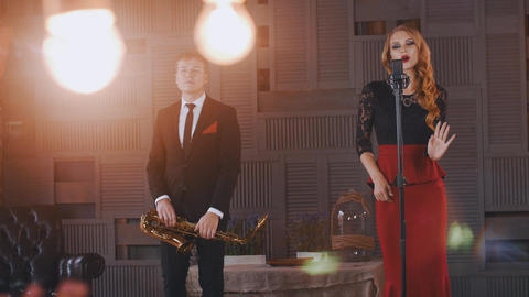 Jazz duet on stage. Saxophonist and vocalist. Retro style dress. Artists Footage