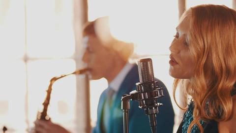 Jazz duet perform in restaurant. Singer. Saxophonist. Retro style. Spotlights Footage