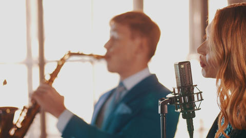 Jazz couple perform in restaurant. Vocalist. Saxophonist. Retro style. Musicians Footage