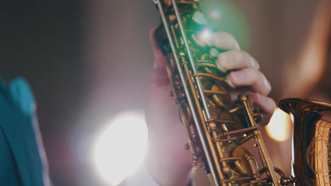 Saxophonist playing on golden saxophone. Live performance. Jazz artist. Musician Footage