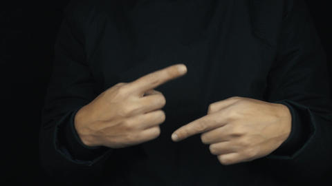 Male hands in long sleeve jacket twisting pointing fingers around Footage