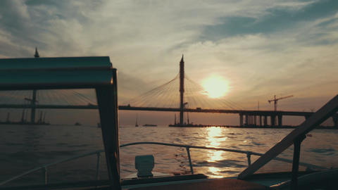 Boat floating to summer beautiful sunset. Bridge. Nature. Romantic evening Footage