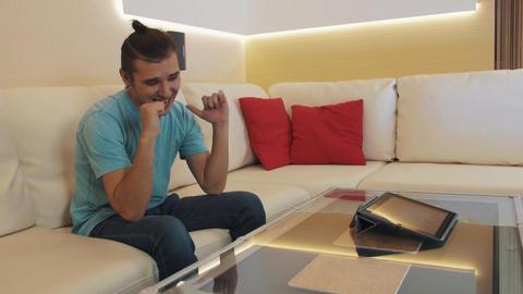 Joyful videoblogger put smartphone on table, starts live video stream, wave talk Live Action