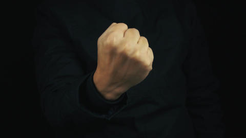 Male hand in long sleeve jacket pulling fist up, make... Stock Video Footage