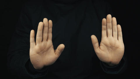 Male hand in long sleeve jacket palms stopping and italian stereotype gestures Footage