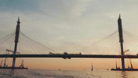 Huge bridge in city in summer evening. Beautiful sunset. River. Nature Footage