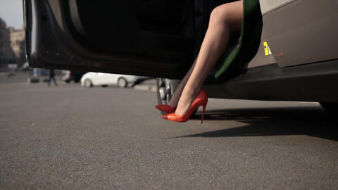 Sexy legs in high heel shoes getting out of car Footage