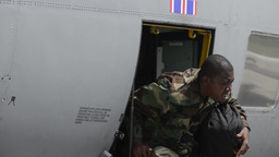 Troops arrive on C-130 Hercules transport aircraft Stock Video Footage