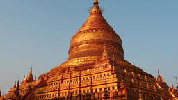 Shwezigon Pagoda with people in Bagan of Myanmar - camera motion up and down Footage