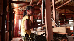 Women working on textile machine indoors - Myanmar, Nyaung Shwe - video sequence Footage