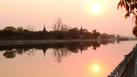 Sunset and night in Myanmar Mandalay with Royal palace and hill silhouette view  Footage