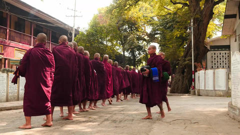 Monks formation and parade near monastery in Myanmar closeup - 2 videos sequence Footage