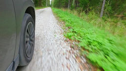 Car wheel spinning POV - Point of View, country side. Forest Footage