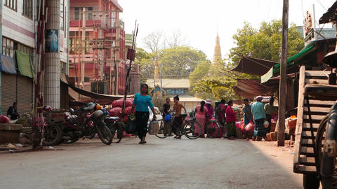 inside Street of Mandalay city in Myanmar with Pagoda view afar Footage