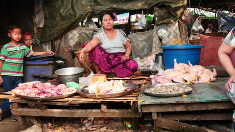 Woman - meat seller in bazaar and Small cafe in Yangon - seller communicate with Footage