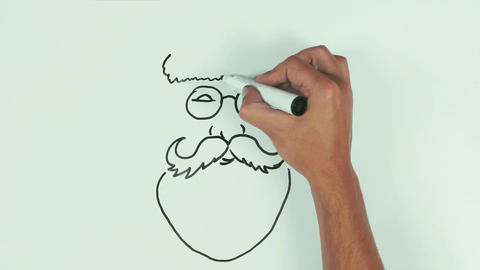 Man hand draw santa claus face using black marker pen on whiteboard and wipe it Live Action