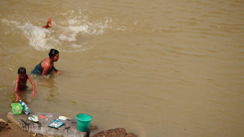 Lucky Myanmar family washing in Irrawaddy river - few videos sequence Footage