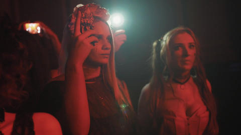 Girls in halloween costumes and makeover filming with smartphone at night club Footage