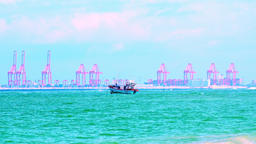 Fishing boat swaying on sea waves against marine port cargo terminal. Sri Lanka Footage