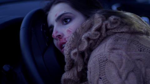 Dead woman in car at night after accident Live Action
