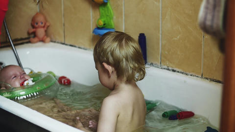 Little boy in bathtub. Baby swim in inflatable circle. Crying. Children. Bathing Footage