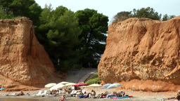 Europe Spain Balearic Ibiza coves and landscapes 046 opening in red steep rock Footage