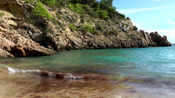 Europe Spain Balearic Ibiza coves and landscapes 066 small bay with breakers Footage