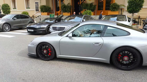 Man Driving An Expensive Gray Porsche 911 GT3 In Monaco Live Action