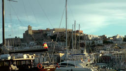 Europe Spain Balearic Ibiza towns and villages 077 the castle behind ship masts Footage