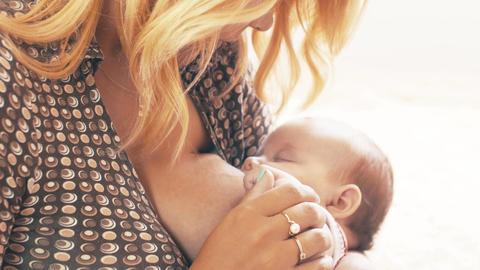 Young mother breastfeeding little baby. Motherhood. Healthy feeding. Family Footage