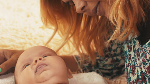Mother lie with little baby. Motherhood. Cute. Child. Mothering. Love Footage