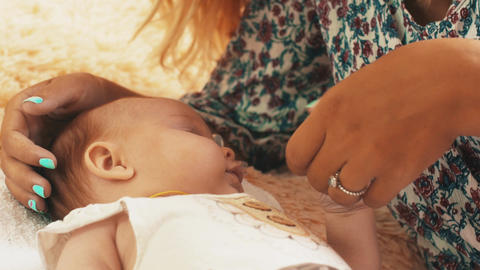 Young mother playing with little baby. Motherhood. Mothering. Care. Love Footage