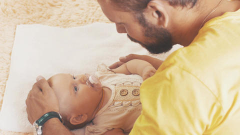 Bearded father stroking on head little adorable baby. Parent. Communication Footage