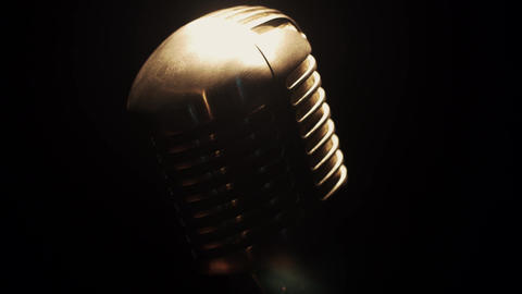 View at concert glare microphone stay on stage in retro club under spotlight Footage