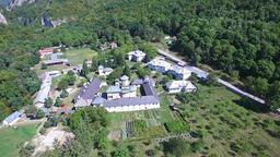 Polovragi Monastery, Romania aerial view, tilt Footage