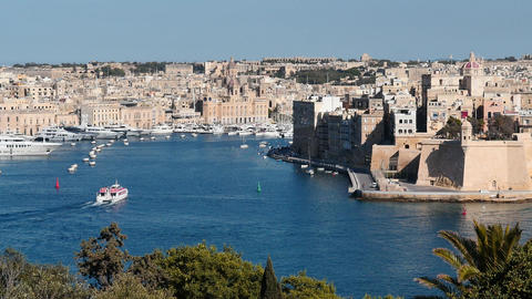 Passenger boat floating in blue Valletta waters with beautiful waterfront view Footage