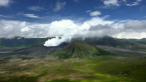 Gases emitted from vent of active volcano. Bromo seismic activity. Indonesia Live Action