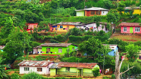 Zooming video. Small village with colorful houses at tea plantations. Sri Lanka Footage