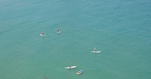 People Having Fun In Small Boats And Surf Paddle Boards Footage