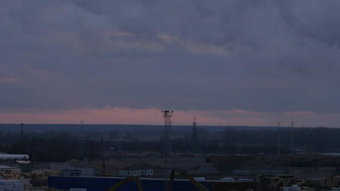 birds eye view of industrial zone in Riga, Latvia time lapse at late evening Footage