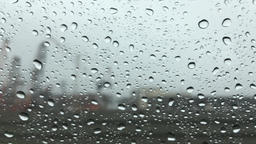 Looking through rainy glass on a bumpy car ride Footage