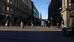 Few citizens walk at Keskuskatu street, car ride along Aleksanterinkatu on fore Footage