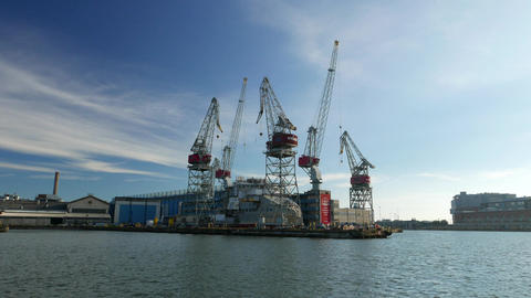 Motionless gantry cranes at Helsinki shipyard. Calm and sunny autumn day Footage
