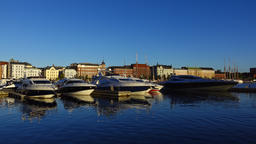Tranquil scene of city pier with modern luxury yachts at early morning Live Action